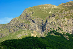 Rocky mountain peak with waterfall Royalty Free Stock Image
