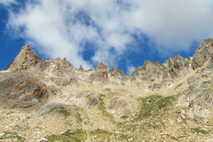 Rocky mountain peaks and clouds Stock Photography
