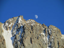 Rocky mountain peaks and moon Royalty Free Stock Photo