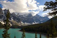 Rocky mountain peaks and moraine lake Stock Photos