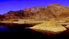 Rocky mountain pyramide island reflection stock image