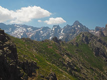 Rocky mountain ridge with snow spotted mountains backround Stock Photography