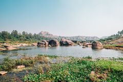 Rocky mountain and river in Hampi, India