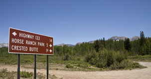 Rocky Mountain road sign. Sign by a forest dirt road on the West Elk Loop scenic byway in the West Elk Mountains near Kebler Pass, Colorado, America Royalty Free Stock Images