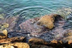 Rocky mountain on the seashore stock image