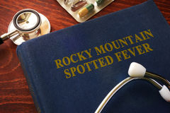 Rocky Mountain spotted fever RMSF. Book with title Rocky Mountain spotted fever RMSF stock photos