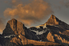 Rocky Mountain Sunrise. The Three Sisters mountains in Canmore Alberta Canada's Rocky Mountains at sunrise Royalty Free Stock Photo