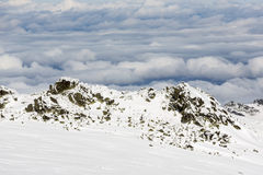 Rocky mountain top in snow cloudy Royalty Free Stock Photos
