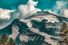 Rocky Mountain Under Blue Cloudy Sky Royalty Free Stock Photography