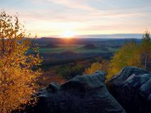 Rocky mountain with view into evening autumnal valley. Fantastic dreamy sunset on top of rocky mountain with view into evening autumnal valley. Mountain view Royalty Free Stock Photo