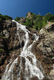 Rocky mountain waterfall. Scenic view of rocky waterfall, Fagaras, Southern Carpathians, Romania Stock Photo