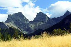 Rocky Mountains. Rocky Mountain peaks called the Three Sisters in Canmore, Alberta Royalty Free Stock Images