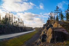 Rocky mountains along the highway A-121 Sortavala in Karelia. Russia. Autumn landscape highway A-121 Sortavala in Karelia. Russia stock photo