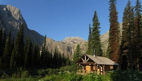 Rocky mountains back country ranger station and falls Royalty Free Stock Photo