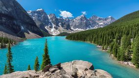 Rocky Mountains, Banff National Park, Canada. Beautiful turquoise waters of the Moraine Lake with snow-covered peaks above it in Rocky Mountains, Banff National Stock Photos