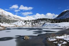 Rocky Mountains - Canada. Rocky mountains, forest and frozen river, Canada stock photos
