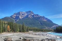 Rocky Mountains in Canada with creek bed in foreground. The Rocky Mountains in Canada with creek bed in foreground royalty free stock image