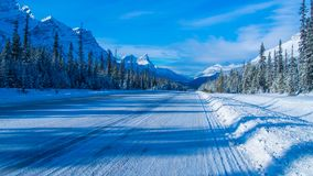 The Rocky Mountains in Canada. Winter road in Canada. Sunny day in winter royalty free stock photo