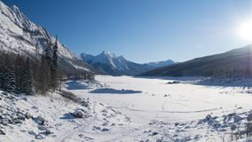 The Rocky Mountains in Canada. Winter lake in Canada. Sunny day in winter stock photography