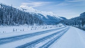 The Rocky Mountains in Canada. Winter road in Canada. Sunny day in winter royalty free stock images