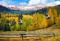 Rocky Mountains and a chair lift. Rocky Mountains in the fall with aspen Stock Image