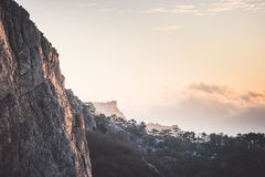 Rocky Mountains Cliff And Clouds Sunset Landscape Royalty Free Stock Image