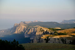 Rocky mountains cliff and blue sky with white clouds. Amazing view of the mountain range at sunset Stock Image