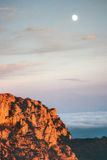 Rocky Mountains cliff and moon sunset Landscape Stock Images