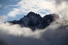 Rocky mountains in the clouds Royalty Free Stock Photo