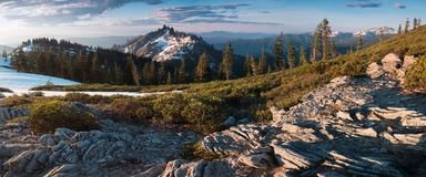 Rocky mountains covered with the last snow near Mount Shasta volcano. Castle dome from Castle Crags State Park, Castle Crags stock image