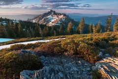 Rocky mountains covered with the last snow near Mount Shasta volcano. Castle dome from Castle Crags State Park, Castle Crags. Wilderness, California, USA stock photography