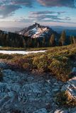Rocky mountains covered with the last snow near Mount Shasta volcano. Castle dome from Castle Crags State Park, Castle Crags. Rocky mountains covered with the stock image