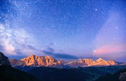 Rocky Mountains at Fantastic starry sky. Dolomite Alps, Italy.  Royalty Free Stock Image