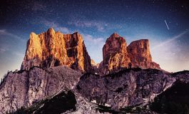Rocky Mountains at Fantastic starry sky. Dolomite Alps, Italy.  Stock Photo
