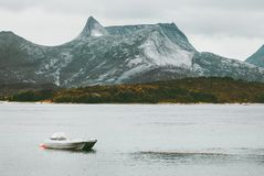 Rocky Mountains and fishing boat sea wild Landscape in Norway scandinavian. Travel Stock Images