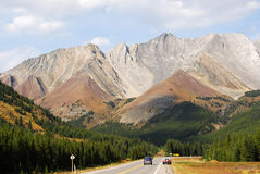 Rocky mountains and highway Stock Images