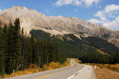 Rocky mountains and highway Royalty Free Stock Image