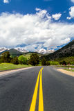 Rocky mountains. Highway through the rocky mountains, distant snow caped mountains stock photography