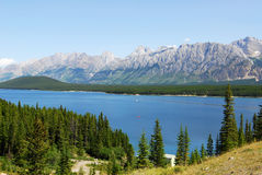 Rocky mountains and lake stock images