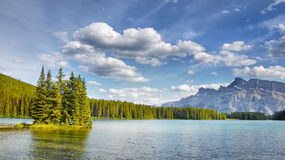 Rocky Mountains Lake, Canada. Rocky Mountains lake and forest scenery, Canada Stock Images