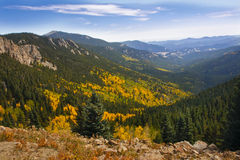 Rocky mountains landscape. Scenic view of Autumnal forest in Rocky mountains or Rockies with blue sky and cloudscape background, Colorado, U.S.A Royalty Free Stock Photography