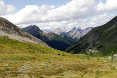 Rocky mountains and meadows Royalty Free Stock Photo