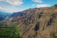 Rocky mountains in Na Pali Coast State Wilderness Park, shot taken from a helicopter, Kauai, Hawaii, USA. Aerial view of mountains in Na Pali Coast State royalty free stock image