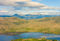 The rocky mountains nestled behind a small town in canada Royalty Free Stock Photo