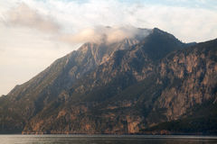 Rocky Mountains over the sea. Royalty Free Stock Images