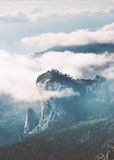 Rocky Mountains peak cliff and clouds foggy Landscape Royalty Free Stock Image