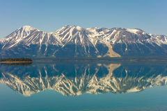 The rocky mountains reflected in a lake Stock Photography