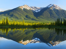 Rocky Mountains Reflecting on Still Lake. The Rockies reflecting on Vermilion Lakes at Sunset Royalty Free Stock Image