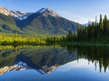 Rocky Mountains Reflecting on Still Lake. The Rockies reflecting on Vermilion Lakes at Sunset Royalty Free Stock Photography
