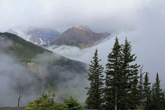 Rocky Mountains Shrouded in Fog - Alberta Stock Photography